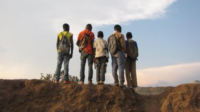 Young boys preparing to collect rocks at North Mara mine waste dump